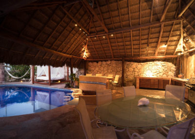 Pool palapa with dining area, bar, swimup bar and outdoor kitchen